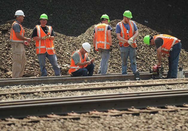 Work continues on the track crossing in the vicinity of Friday's train derailment and collision in Bridgeport, Conn. on Tuesday, May 21, 2013. Photo: Brian A. Pounds / Connecticut Post