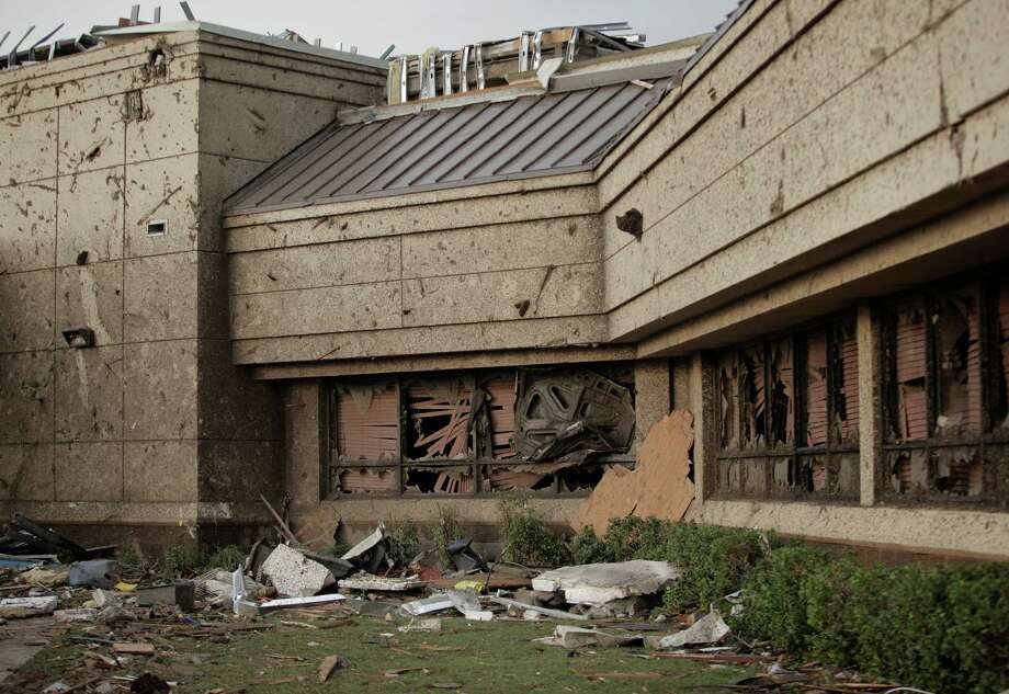 The hood of car is wedged into the front window of the Moore Medical Center after a powerful tornado ripped through the area on May 20, 2013 in Moore, Oklahoma. The tornado, reported to be at least EF4 strength and two miles wide, touched down in the Oklahoma City area on Monday killing at least 51 people. Photo: Brett Deering, Getty Images / 2013 Getty Images