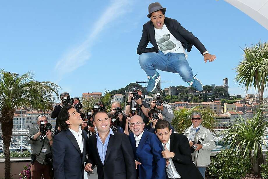 "The critics said the film jumped the shark: French actor Jamel Debbouze jumps above actor Tewfik Jallab, director Mohamed Hamidi, French-Algerian actor Fatsah Bouyahmed and French comedian Malik Bentalha during a photo shoot for the film ""Ne Quelque Part"" (Homeland) at the Cannes Film Festival. Photo: Loic Venance, AFP/Getty Images"