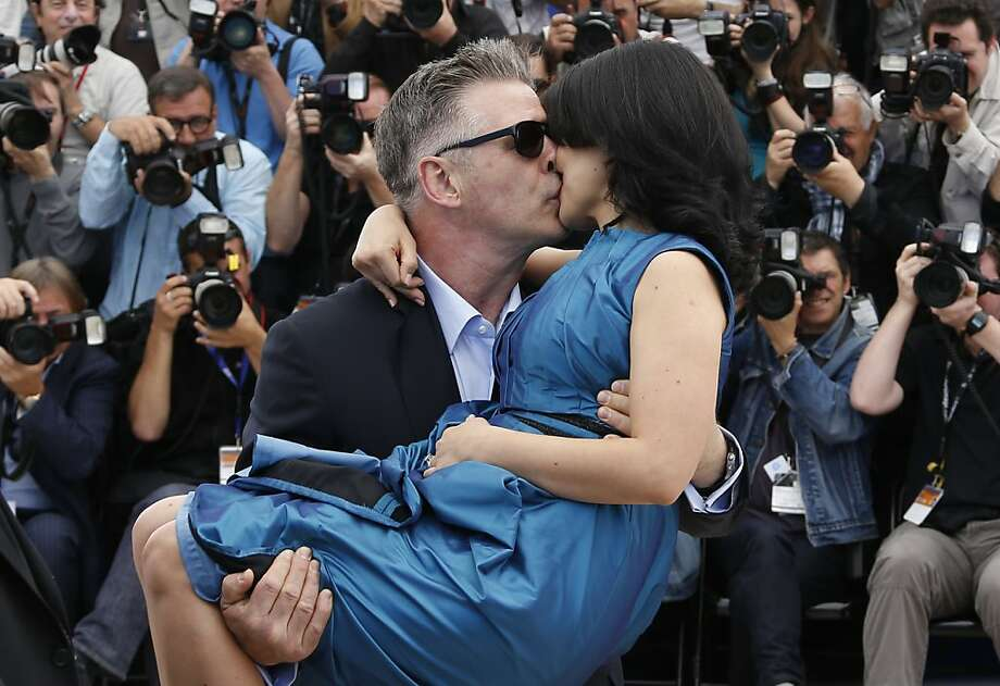 "Seduced maybe, abandoned no: Actor Alec Baldwin kisses his wife Hilaria Thomas during a photo shoot for the film ""Seduced and Abandoned""  at Cannes.   Photo: Valery Hache, AFP/Getty Images"