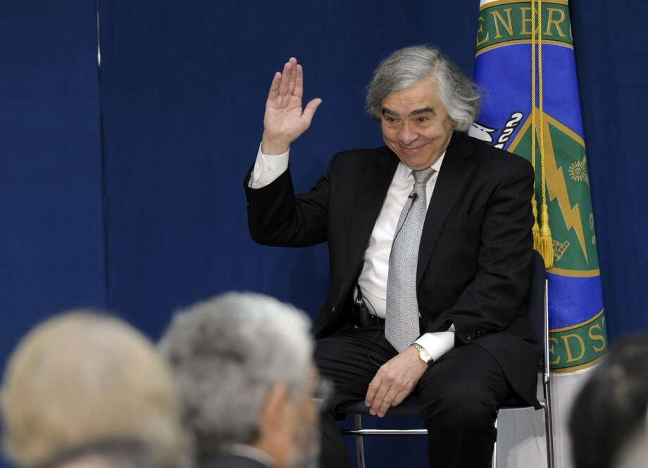 Dr. Ernest Moniz waves to the audience before the start of a ceremony where he was  sworn in as Energy Secretary, Tuesday, May 21, 2103,  at the Energy Department in Washington. (AP Photo/Susan Walsh) Photo: Associated Press