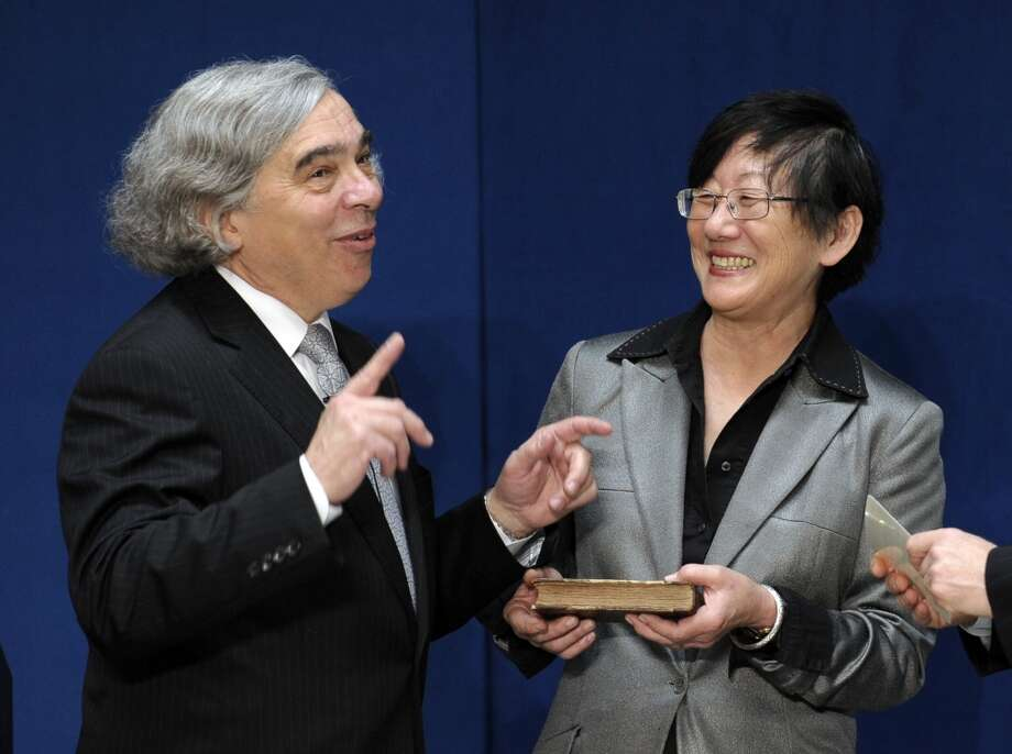 Dr. Ernest Moniz stands with his wife Naomi prior to taking the oath of office as Energy Secretary of Energy, Tuesday, May 21, 2013, during a ceremony at the Energy Department in Washington. (AP Photo/Susan Walsh) Photo: Associated Press