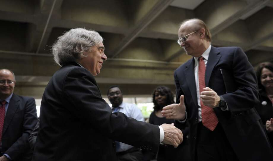 Dr. Ernest Moniz, left, greets people after being sworn in as the Energy Secretary, Tuesday, May 21, 2013, during a ceremony at the Energy Department in Washington. Moniz, 68, a professor at the Massachusetts Institute of Technology, replaces Steven Chu, who served as energy secretary in President Barack Obama's first term. Moniz served as an energy undersecretary in the Clinton administration. (AP Photo/Susan Walsh) Photo: Associated Press