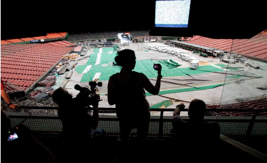 People take photos and video from a suite during a media tour of the Reliant Astrodome Thursday, March 21, 2013, in Houston. ( Melissa Phillip / Houston Chronicle ) Photo: Melissa Phillip, Houston Chronicle / © 2013  Houston Chronicle