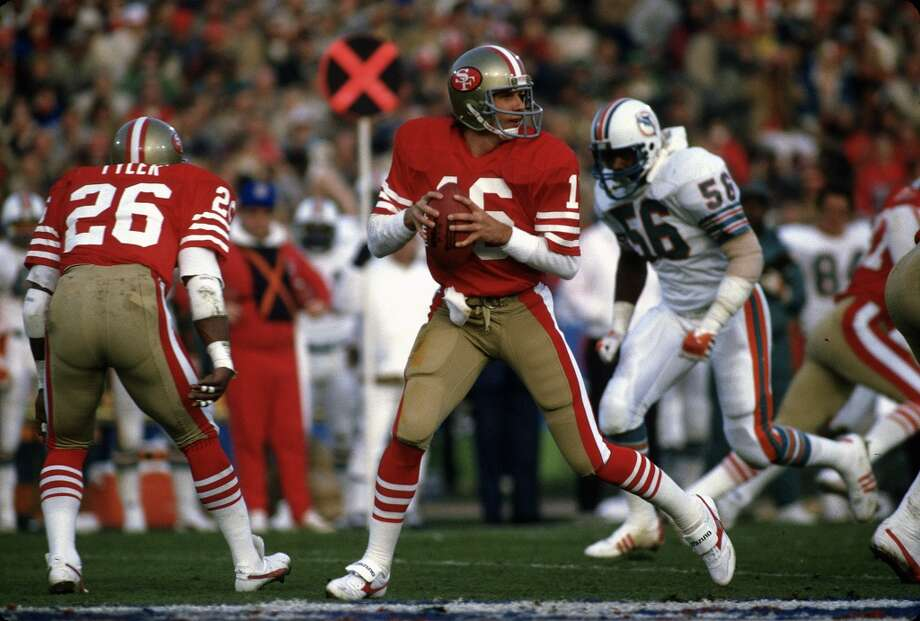 Joe Montana drops back to pass against the Miami Dolphins during Super Bowl XIX  on January 20, 1985 at Stanford Stadium in Palo Alto, California. The 49ers won the Super Bowl 38-16 and Montana was the gams MVP.
