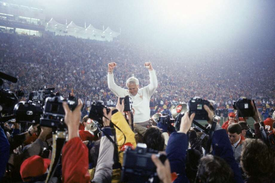 Head coach Bill Walsh enjoys a victory ride on the field after defeating the Miami Dolphins 38-16 in Super Bowl XIX at Stanford Stadium on January 20, 1985 in Stanford, California.