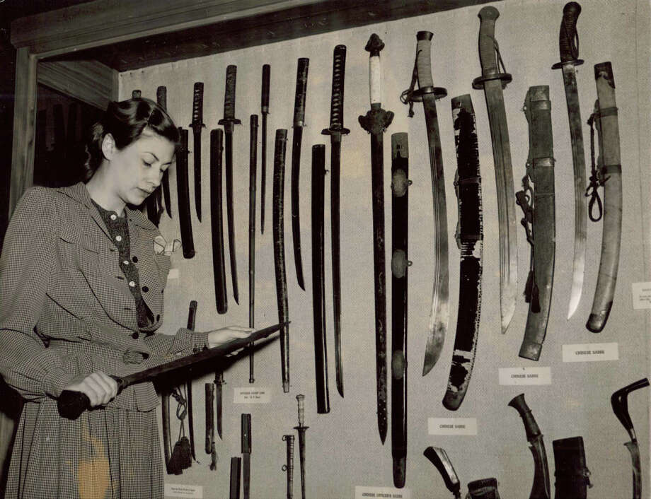Cecilia Steinfeldt with edged weapons display Dec. 1941. Photo: COURTESY WITTE MUSEUM