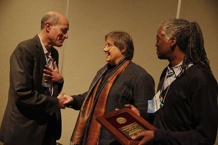 Health issues activist Caitlin Ryan (center) receives recognition from the American Psychiatric Association at its annual conference. With her are Dr. Philip Bialer (left) and Dr. Kenneth Ashley. Photo: Lea Suzuki, The Chronicle