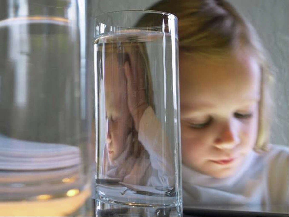 """Torrance York of New Canaan was named the grand prize winner in the """"professional serious amateur"""" category of Fairfield Museum and History Center's juried photography exhibition for her piece, """"Refractions 3/19/12 #1150,"""" an image of her 7-year-old daughter."""