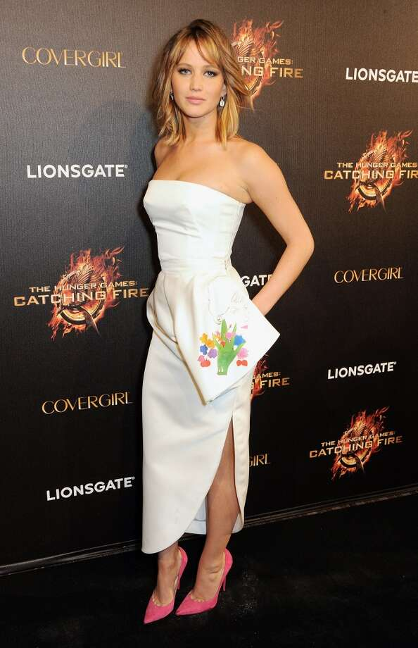 Actress Jennifer Lawrence arrives on the Red Carpet at Lionsgate's 'The Hunger Games: Catching Fire' Cannes Party at Baoli Beach sponsored by COVERGIRL on May 18, 2013 in Cannes, France.  (Photo by Dave M. Benett/Getty Images for Lionsgate)
