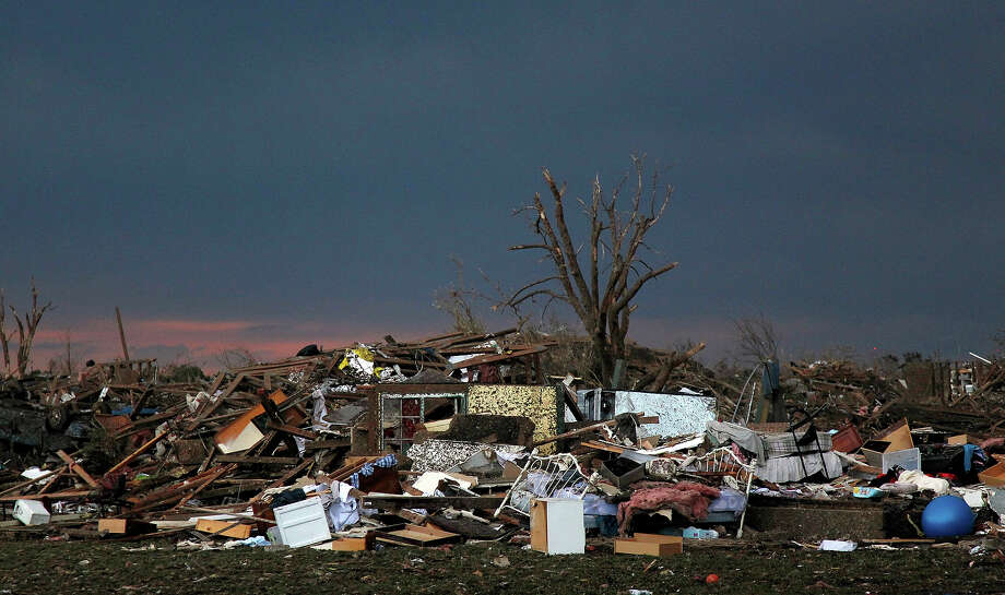 The rubble of a destroyed neighborhood lay mixed together where it fell  Tuesday, May 21, 2013 a day after a tornado moved through Moore, Okla. The huge tornado roared through the Oklahoma City suburb Monday, flattening entire neighborhoods and destroying an elementary school with a direct blow as children and teachers huddled against winds. Photo: Brennan Linsley, ASSOCIATED PRESS / AP2013