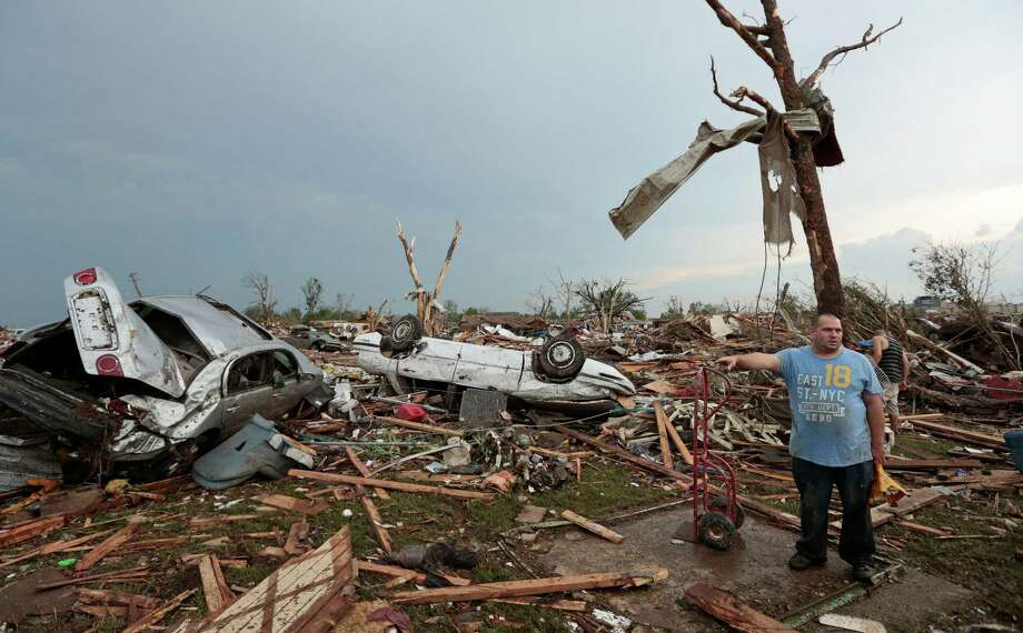 Philip Gotcher stands in the rubble of his house after a powerful tornado ripped through the area on May 20, 2013 in Moore, Oklahoma. The tornado, reported to be at least EF4 strength and two miles wide, touched down in the Oklahoma City area on Monday killing at least 51 people. Photo: Brett Deering, Getty Images / 2013 Getty Images