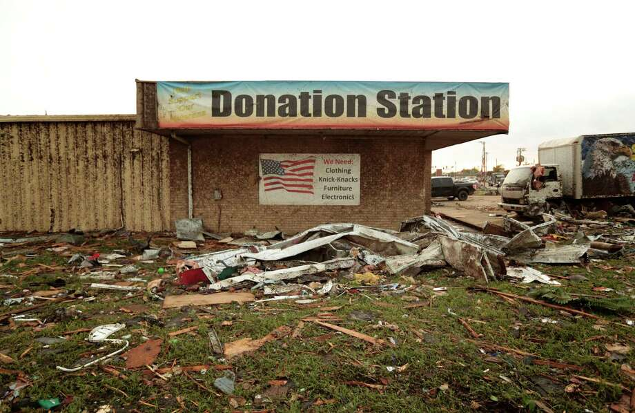 A Goodwill donation station is surrounded by debris after a powerful tornado ripped through the area on May 20, 2013 in Moore, Oklahoma. The tornado, reported to be at least EF4 strength and two miles wide, touched down in the Oklahoma City area on Monday killing at least 51 people. Photo: Brett Deering, Getty Images / 2013 Getty Images