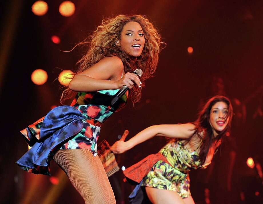 """IMAGE DISTRIBUTED FOR PARKWOOD ENTERTAINMENT - Singer Beyonce performs the song """"Grown Woman"""" on her """"Mrs. Carter Show World Tour 2013"""", on Wednesday, April 24, 2013 at the Palais Omni Sport Bercy in Paris. Beyonce is wearing a custom printed romper with bustle by designer Kenzo. (Photo by Frank Micelotta/Invision for Parkwood Entertainment/AP Images) Photo: Frank Micelotta, INVL / Invision"""