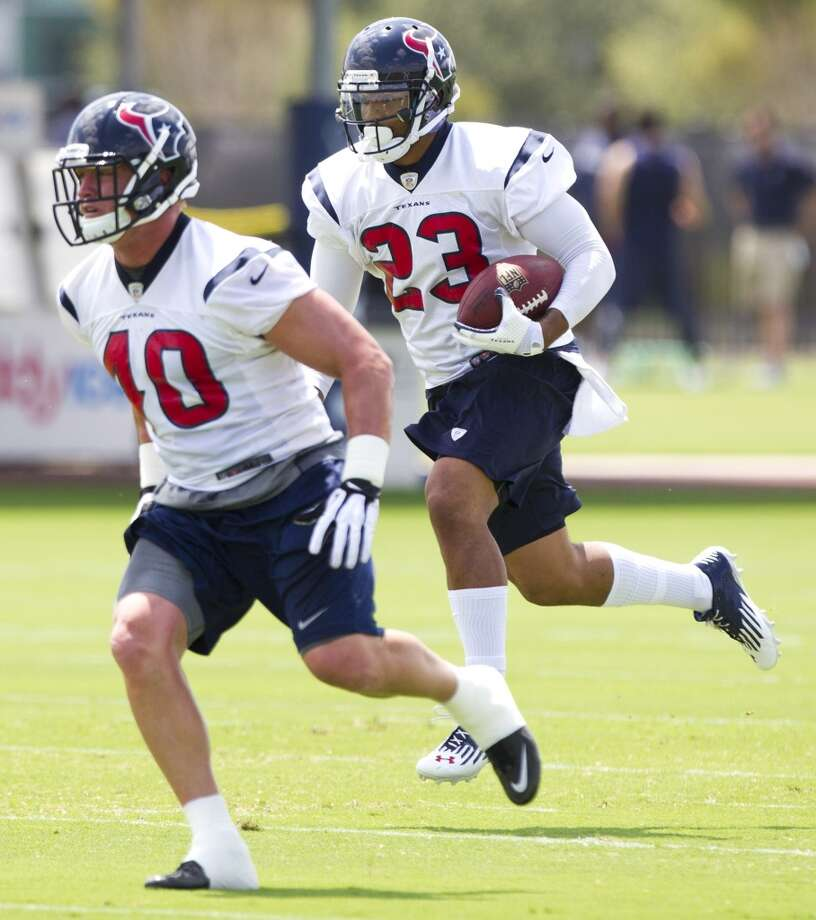 Texans fullback Tyler Klutts (40) leads they way for running back Arian Foster (23).