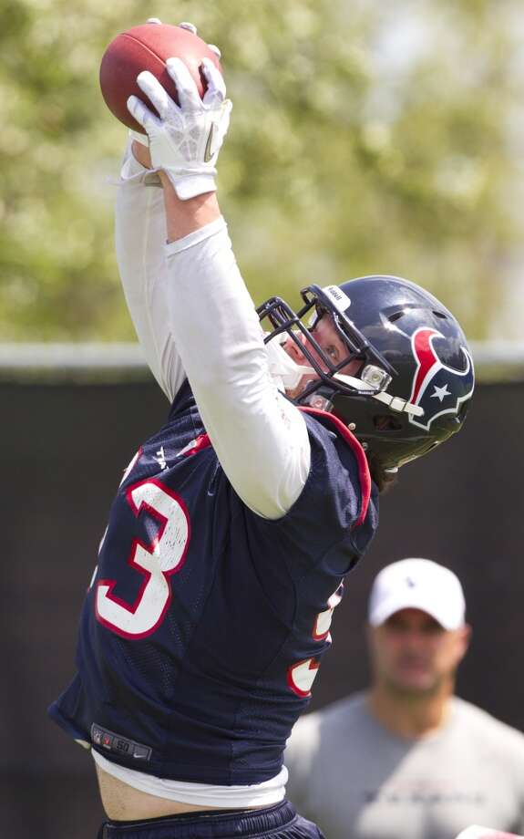 Texans defensive end Jared Crick reaches up to grab a tipped football.