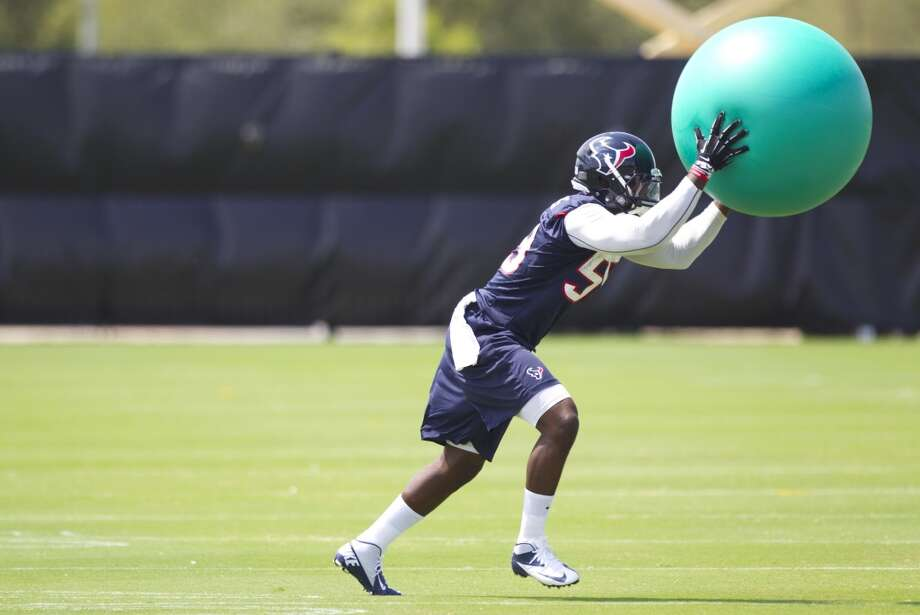 Texans linebacker Whitney Mercilus runs through a drill.