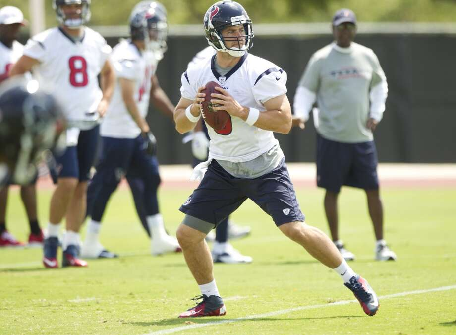 Texans quarterback Stephen McGee drops back to pass.