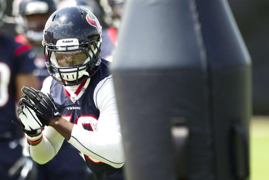 Texans linebacker Whitney Mercilus runs through a set of blocking dummies.