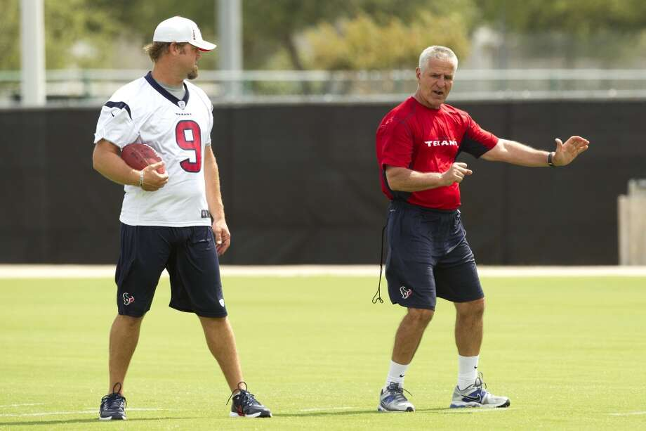 Texans punter Shane Lechler works with special teams coordinator Joe Marciano.