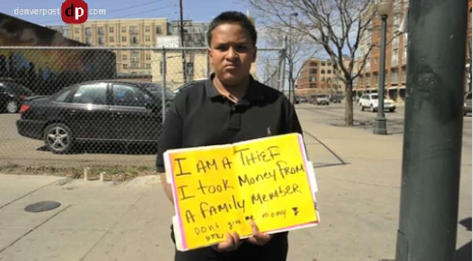 March, 2012: This 12-year-old boy stole money from a family member so his father forced him to hold a shaming sign on a street corner in Denver, Colo. (DenverPost.com)