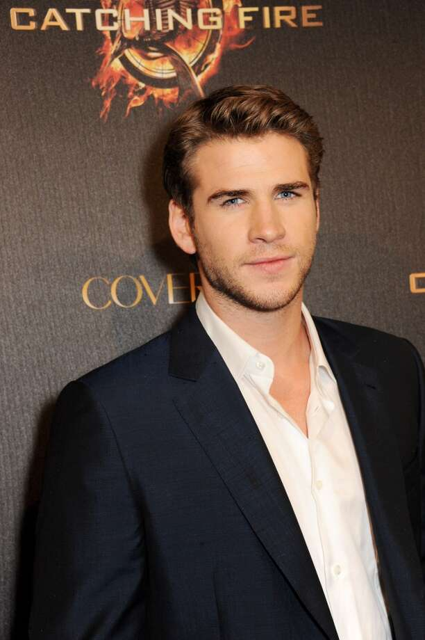 Actor Liam Hemsworth arrives on the Red Carpet at Lionsgate's 'The Hunger Games: Catching Fire' Cannes Party at Baoli Beach sponsored by COVERGIRL on May 18, 2013 in Cannes, France.  (Photo by Dave M. Benett/Getty Images for Lionsgate)