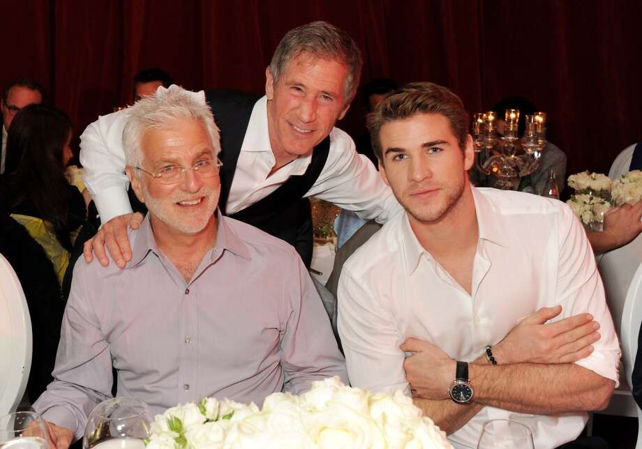 (L to R) Lionsgate Motion Picture Group Co-Chairman Rob Friedman, Jon Feltheimer and actor Liam Hemsworth attend Lionsgate's The Hunger Games: Catching Fire Cannes Party at Baoli Beach sponsored by COVERGIRL on May 18, 2013 in Cannes, France.  (Photo by Dave M. Benett/Getty Images for Lionsgate)