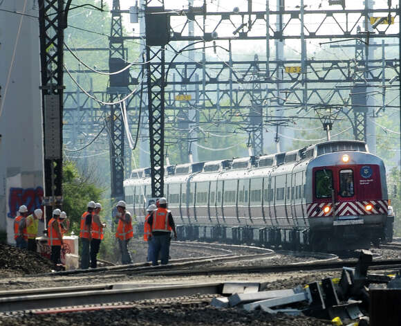The second Metro-North train to rumble though the scene where two trains collided on Friday approaches the Interstate 95 overpass at the Bridgeport/Fairfield border on Tuesday, May 21, 2013. Photo: Cathy Zuraw / Connecticut Post