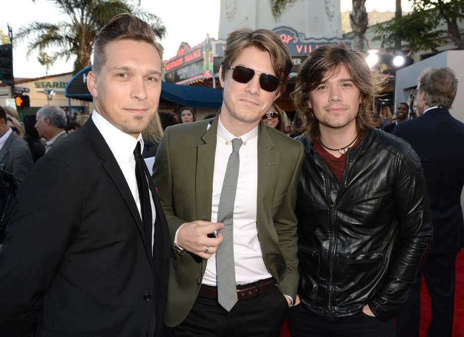 "WESTWOOD, CA - MAY 20:  (L-R) Musicians Isaac Hanson, Taylor Hanson, and Zac Hanson of the band Hanson arrive at the premiere of Warner Bros. Pictures' ""Hangover Part 3"" on May 20, 2013 in Westwood, California.  (Photo by Kevin Winter/Getty Images)"