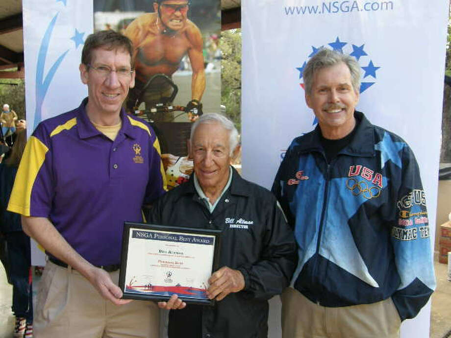 Three-time Olympian Robert Nieman, right, joins NSGA CEO Marc T. Riker, left, in presenting San Antonio's Bill Altman with the NSGA Personal Best Award at the Texas State Senior Games in April. Photo: Courtesy Photo