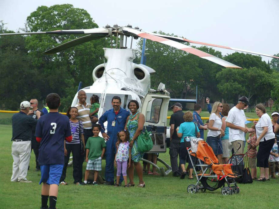 The landing of an AirLife helicopter was a popular attraction during Saturday's Windcrest Volunteer Fire Department annual picnic. Photo: Courtesy Photo / Windcrest Public Relations