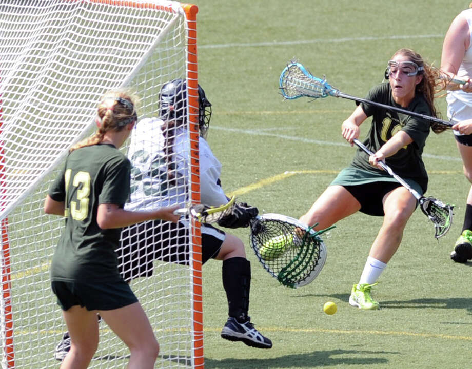 At right, Sasha Fritts of Greenwich Academy scores a first half goal past Maddie Pillari of Convent of the Sacred Heart during the FAA girls lacrosse championship between Greenwich Academy and Convent of the Sacred Heart at Greenwich Academy, Tuesday afternoon, May 21, 2013. Greenwich Academy defeated Convent of the Sacred Heart, 18-10, to claim the FAA title. Photo: Bob Luckey / Greenwich Time