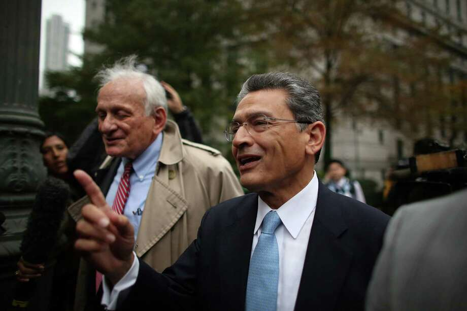 Rajat Gupta (R), former Goldman Sachs director and former senior partner at McKinsey & Co., exits Federal court with his lawyer Gary Naftalis after being sentenced to two years in prison on Oct. 24, 2012 in New York City. Gupta asked a federal appeals court to overturn his insider-trading conviction by arguing the U.S. shouldn't have been allowed to use evidence from wiretapped phone calls that didn't involve him. Photo: Spencer Platt, Getty Images / 2012 Getty Images