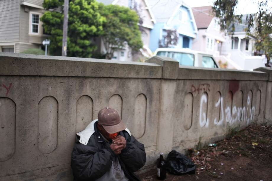 Carmelo Martinez, 49, lights a cigarette on Arlington St just north of the Highland Avenue bridge near College Hill on May 16, 2013 in San Francisco, Calif. Martinez lives nearby, and said he makes sure not to leave bottles or trash behind.