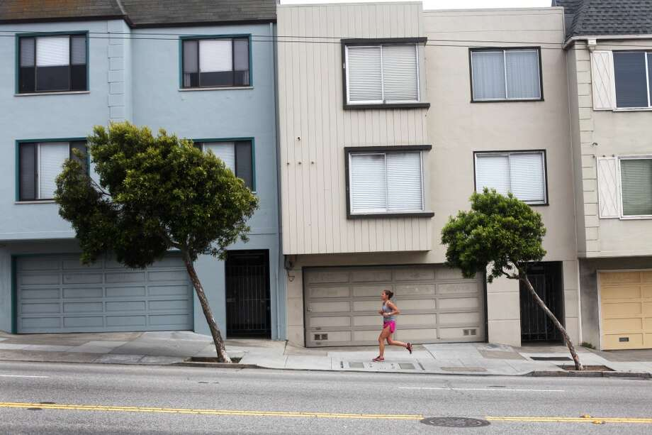 A runner jogs up Mission Street across from College Terrace near College Hill on May 16, 2013 in San Francisco, Calif.