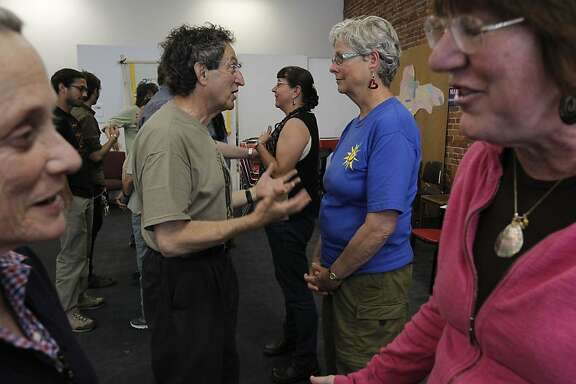 (l to r) Barbara Naiditch, of Oakland, Michael Beer, of Richmond, Marilyn Langlois, of Richmond and Janet Weil, of Concord participate in a de-escalation exercise  during a training session in non violent direct action, on Saturday May 18, 2013, at the Richmond Progressive Alliance in Richmond, Calif., in preparation to protest the construction of the the Keystone XL pipeline.