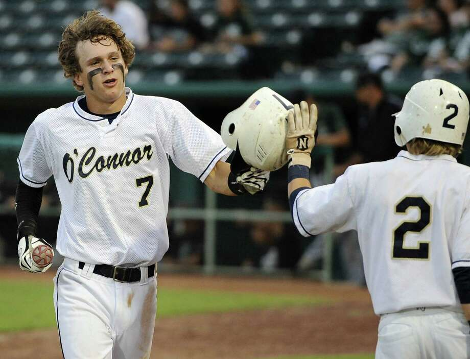 O'Connor's Zachary Galm (7) is congratulated on a run by teammate Zachary Davenport during a class 5A high school baseball playoff game Friday against Corpus Christi King at Wolff Stadium in San Antonio. Photo: Darren Abate / San Antonio Express-News