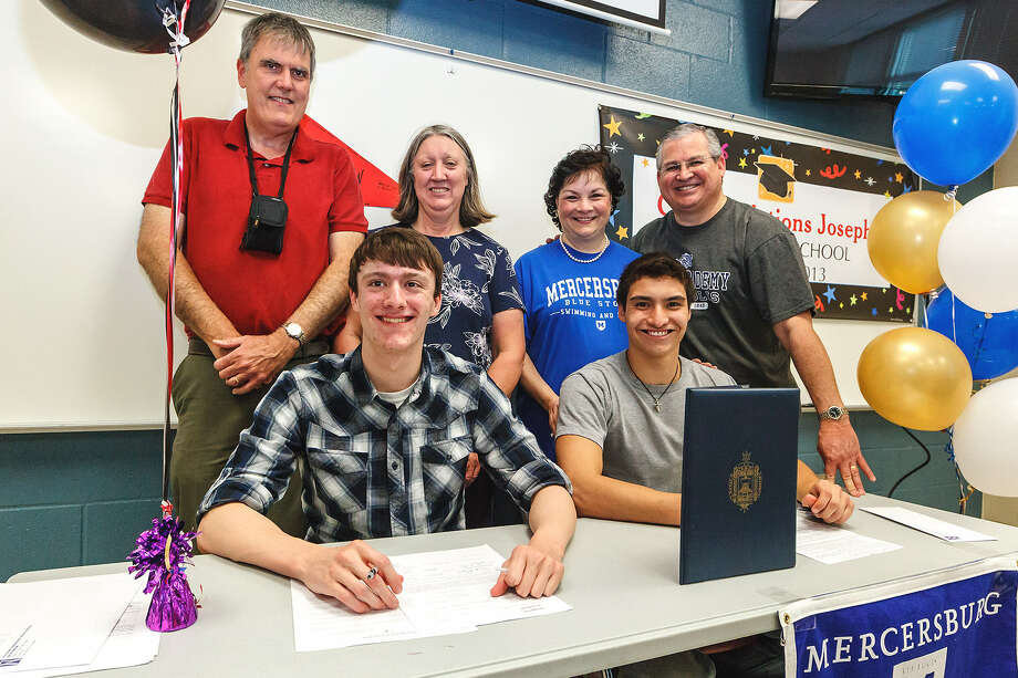 David Moore (left), with parents John and Marnell Moore, and Joseph Jaime, with parents Judi and Jorge Jaime, sign letters of intent to attend the University of Incarnate Word and Mercersburg Academy, respectively.
