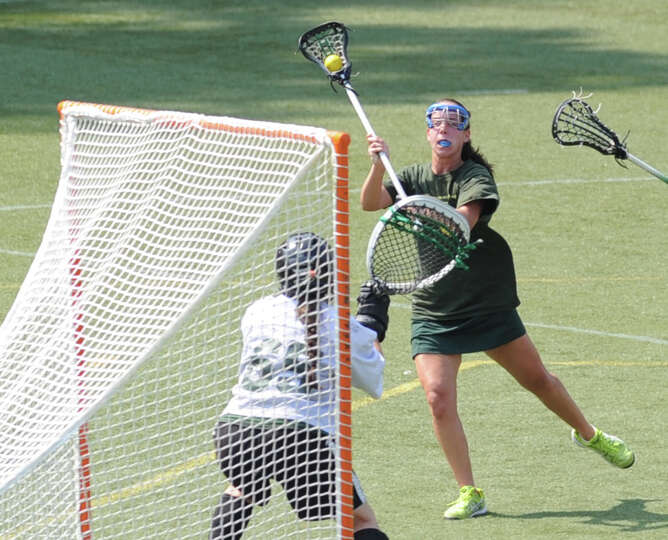 At right, Annie DeFrino (# 5) of Greenwich Academy, shoots on Convent goalie Maddie Pillari during t