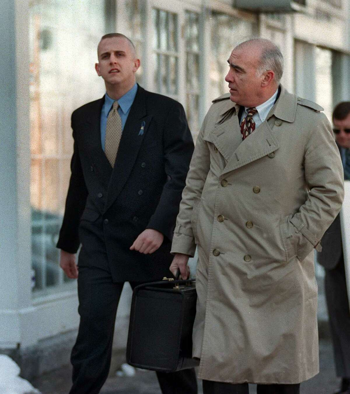 New Milford Police Officer Scott Smith arrives at the Litchfield Superior Court with his attorney, John Kelly for a probable cause hearing in the death of Franklyn Reid.
