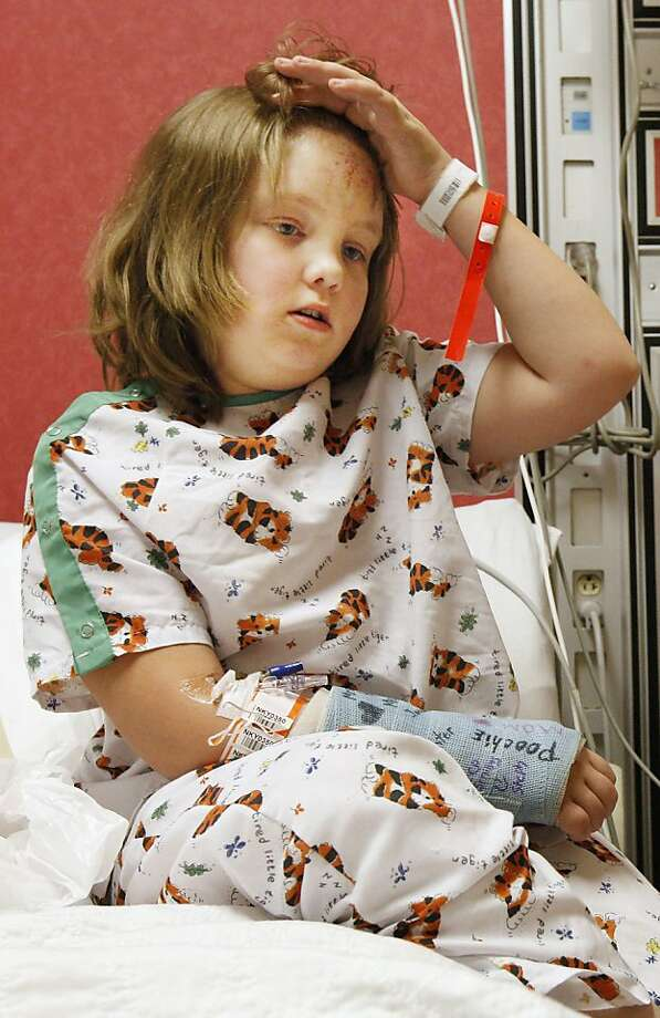 Plaza Towers Elementary second grader Courtney Brown, 8, shows off her bruised forehead as she sits on the edge of her hospital bed at Children's Hospital in Oklahoma City Tuesday, May 21, 2013. Courtney was rescued from the destroyed school in Moore, Okla. after Monday's powerful tornado. Photo: Paul B. Southerland, Associated Press