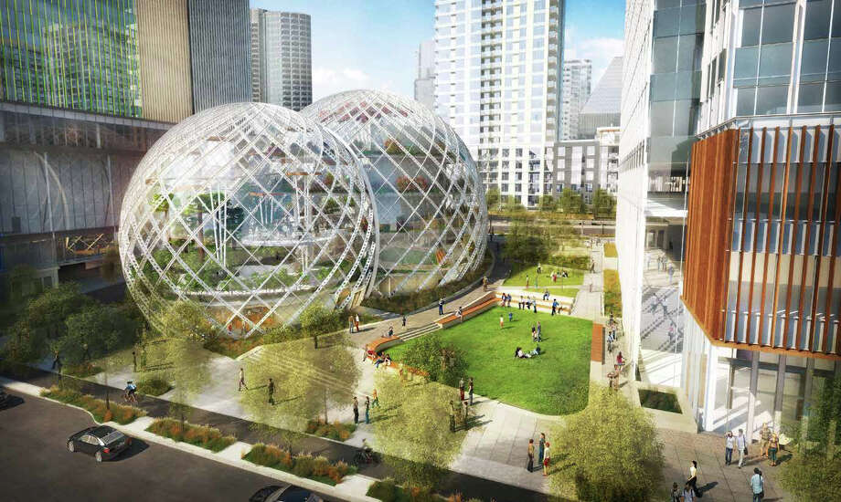 """The biosphere design still calls for open space, with an off-leash dog park and big playing field.   Says Amazon: """"The curvilinear form sets it apart from its immediate surroundings, and consciously avoids the look of a typical corporate office building."""" Or you could just call them giant snow globes.  Photo: NBBJ Via Amazon,  Seattle Design Review Board"""