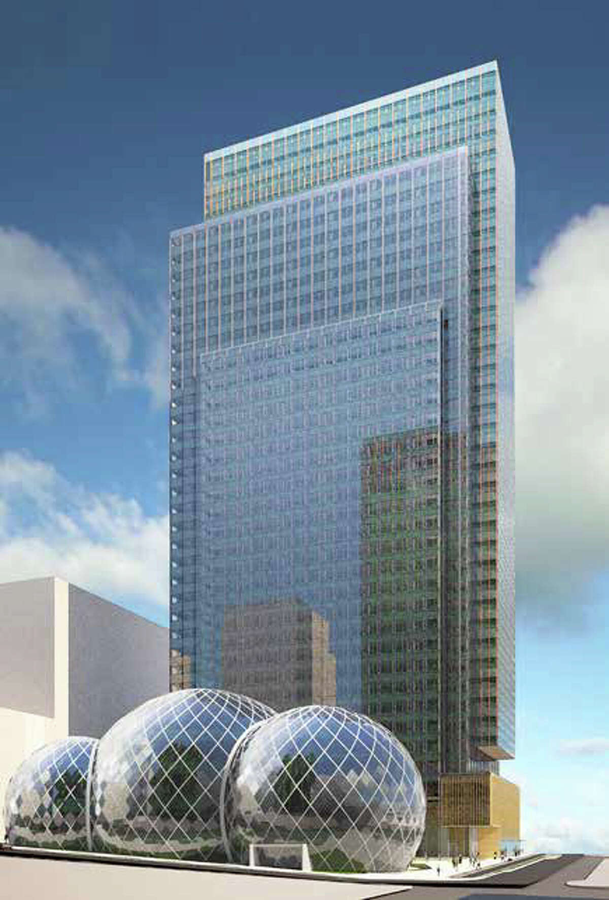 The spheres would be up to five stories high and have about 65,000 square feet of space. Here's the spheres next to one of Amazon's planned towers.