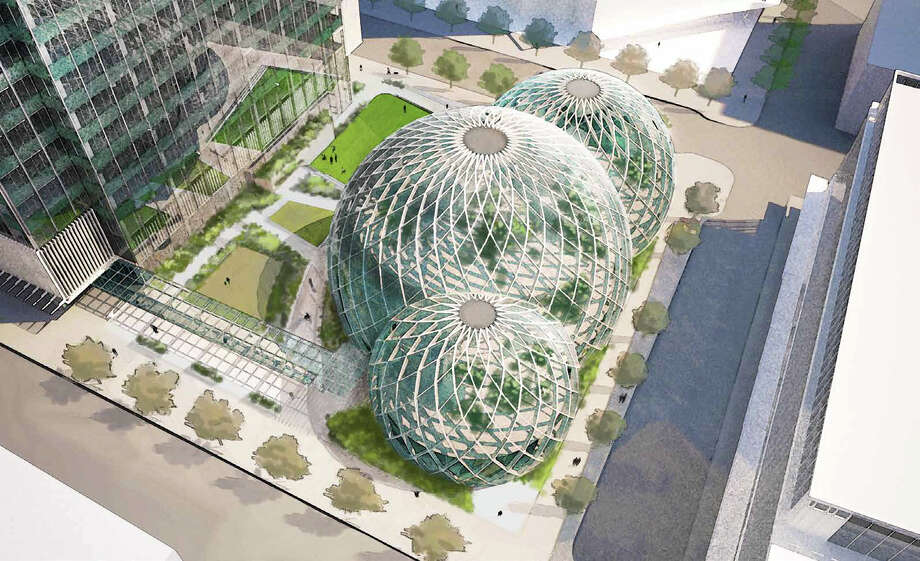 "The building would consist of three connected spheres on one of the blocks that Amazon is rebuilding in South Lake Union. They would resemble a greenhouse or conservatory, with plants that can ""co-exist in a microclimate"" with people, Amazon said.  Photo: NBBJ Via Amazon And Seattle Design Review Board"