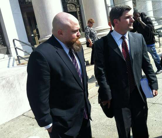 Robert Braddock with his lawyer Frank Riccio II outside the courthouse in New Haven, Conn. on after the conviction on Tuesday, May 21, 2013. Riccio said he will prepare for Aug 13 sentencing and decide on whether to appeal. Photo: Michael P. Mayko / Connecticut Post