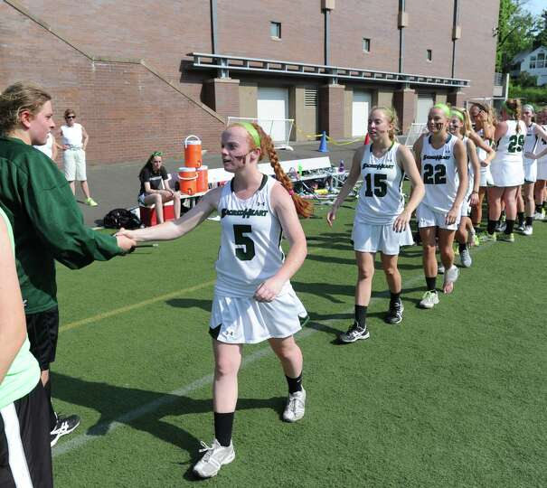 Greenwich Academy goalie Lexi Seidel, left, shakes hands with Convent's Taylor Ryan (# 5) at the con