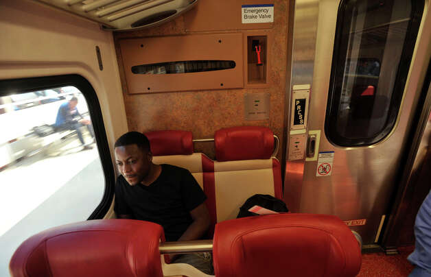 On Tuesday Carlos Nelson commutes on the first train to travel between Fairfield and Bridgeport with passengers since a Metro-North train derailed the week before. On Tuesday, May 21, 2013, limited service between Grand Central and New Haven opened up. Officials plan to have a normal full-service schedule on Wednesday. Photo: Jason Rearick / Stamford Advocate