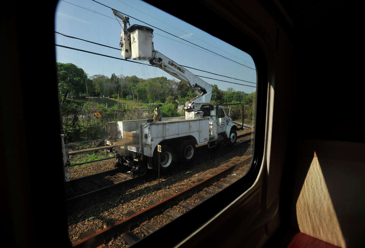 A utility truck is seen through the window of the first train to pass through the section of track on Tuesday, May 21, 2013 where a Metro-North train derailed. On Tuesday, limited service between Grand Central and New Haven opened up. Officials plan to have a normal full-service schedule on Wednesday.