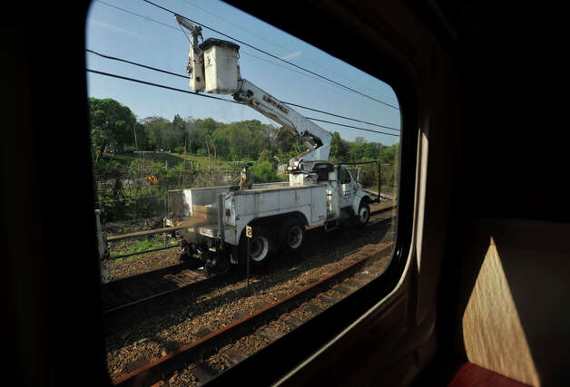 A utility truck is seen through the window of the first train to pass through the section of track on Tuesday, May 21, 2013 where a Metro-North train derailed. On Tuesday, limited service between Grand Central and New Haven opened up. Officials plan to have a normal full-service schedule on Wednesday. Photo: Jason Rearick / Stamford Advocate