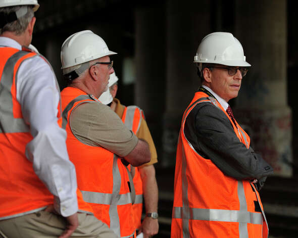 Howard Permut, right, president of MTA Metro-North Railroad, and other officials survey the scene on Tuesday, May 21, 2013 where a Metro-North train derailed the week before. On Tuesday, limited service between Grand Central and New Haven opened up. Officials plan to have a normal full-service schedule on Wednesday. Photo: Jason Rearick / Stamford Advocate